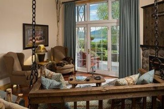Lodge at Moosehead Lake: Baxter suite features a swing sofa from antique boom chains, king bed, double jacuzzi-style tub.