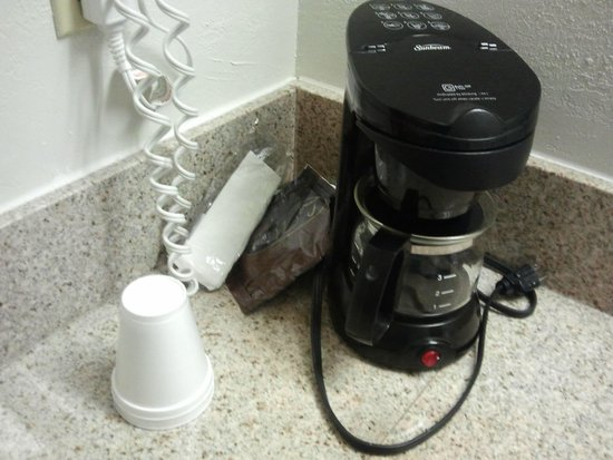 Days Inn Kansas City International Airport: Coffee Maker with unwrapped styrofoam cups sitting directly on the vanity counter