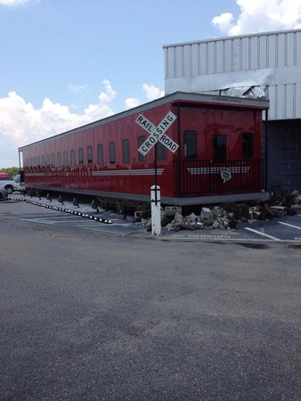 Derailed Diner : Rail car in front of restaurant.
