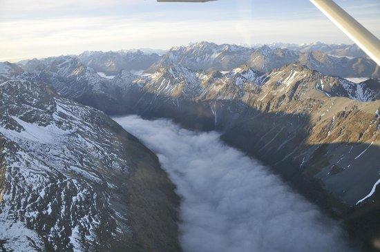 Wakatipu Aero Club: From high above, fog over a lake