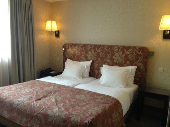 Grand Hotel Casselbergh Bruges: кровать в номере