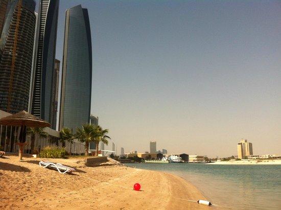 Khalidiya Palace Rayhaan by Rotana: Etihad towers and the hotel's beach