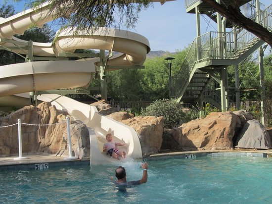 Westin La Paloma Resort and Spa: Are son having fun going down the slide