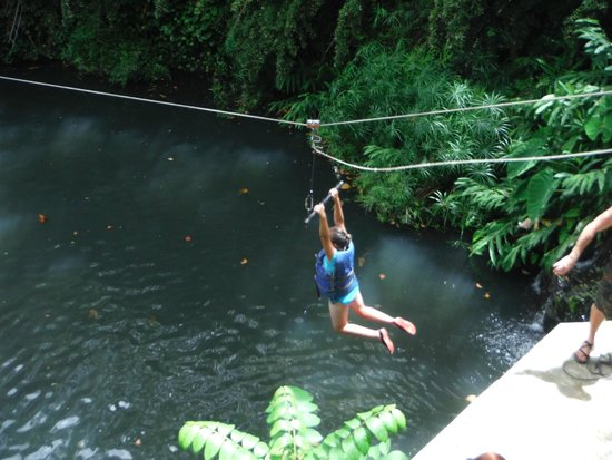 Outriggers zipline: Hang On Grace!! t-barring above jungle pool