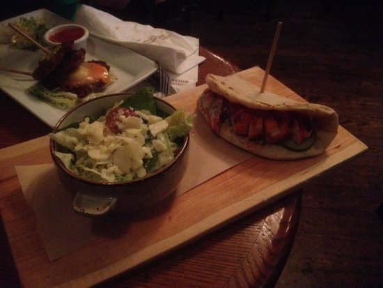 D'arcy McGee's Irish Pub: Chicken Tandoori street meat sandwich with Caesar salad