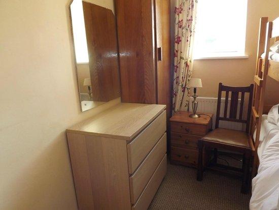 Atlantic Apartotel: mismatched furniture in bunk bedroom