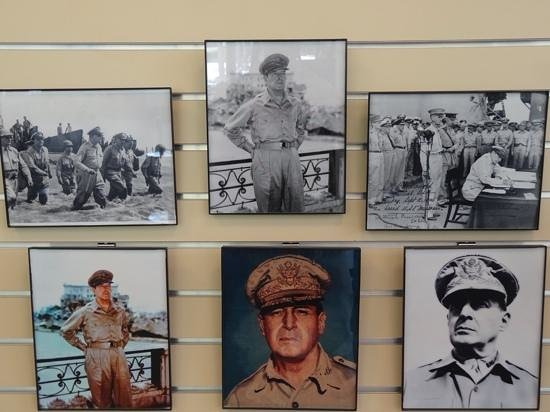 """MacArthur Memorial : his """"signature"""" photos and moments in history"""