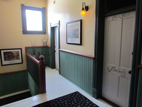 Nobody's Inn : Doors to private bathrooms, from the landing
