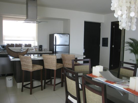 Marival Residences Luxury Resort: Kitchen area of 1 bedroom suite (next to door to outside)