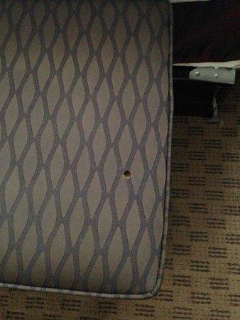 Hotel Zero Degrees: Cigarette burn in cushion