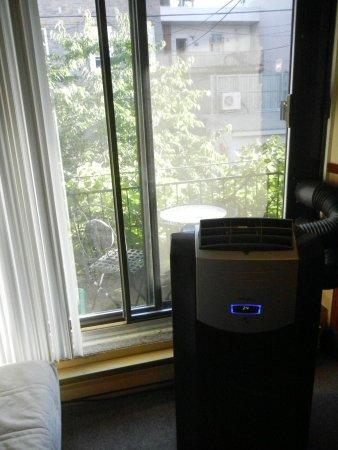Au 4700 Rivard : Air conditioner and sliding door to patio