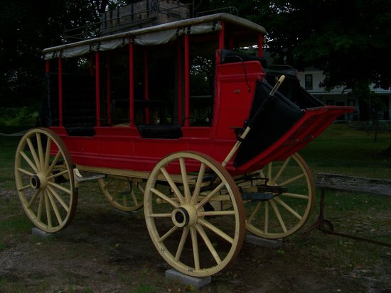 Old Mission Inn: Stagecoach and Covered Wagon in Front of Inn
