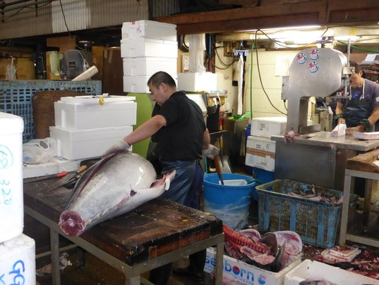 The Tsukiji Market: Cutting up large fish (perhaps tuna?)