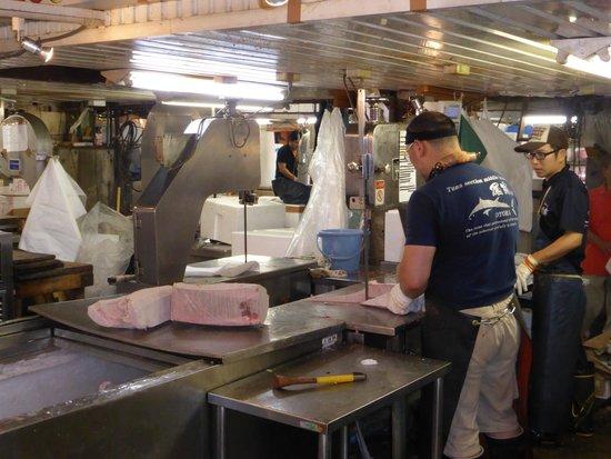 The Tsukiji Market: Cutting frozen blocks of fish