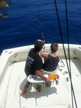High Noon Sport Fishing: First mate Lee giving instruction on how to reel in a Marlin.
