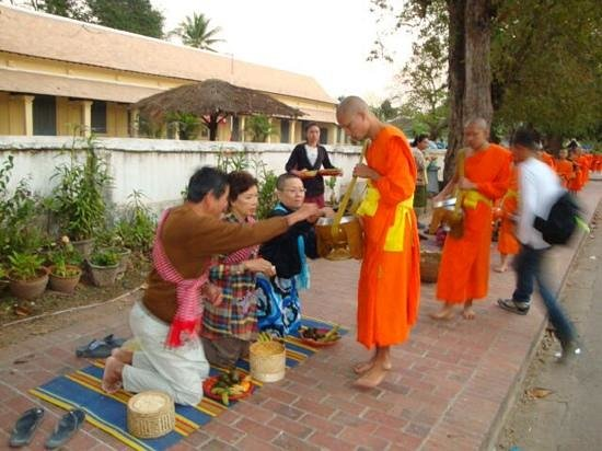 Satri House: Takbaht, offering food to monks.