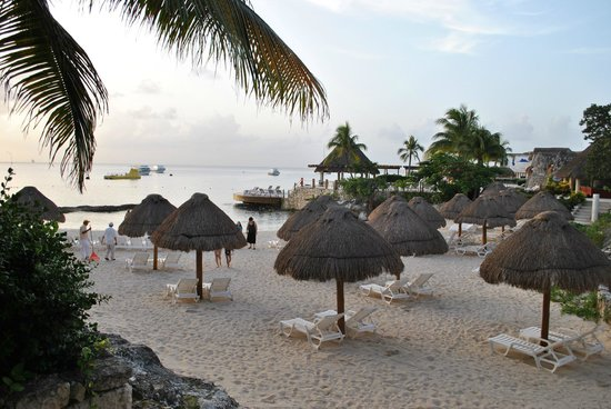 Grand Park Royal Cozumel: Beach area with individual tiki huts for shade (no extra cost)