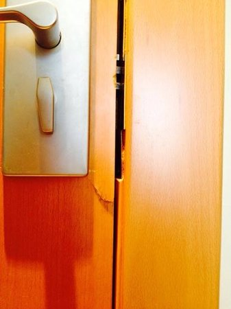 Expo Hotel Barcelona: damaged door- someone tried to leave in a hurry!