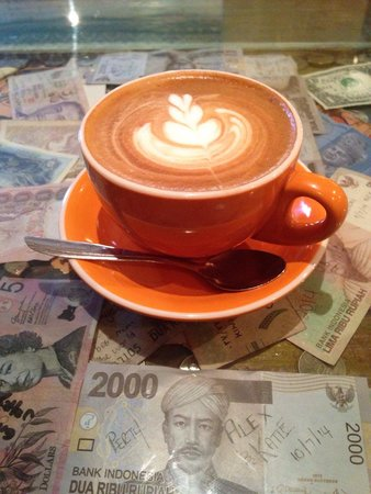 Revolver Espresso: A mug of extra hot latte upon the tables of tales and currency...