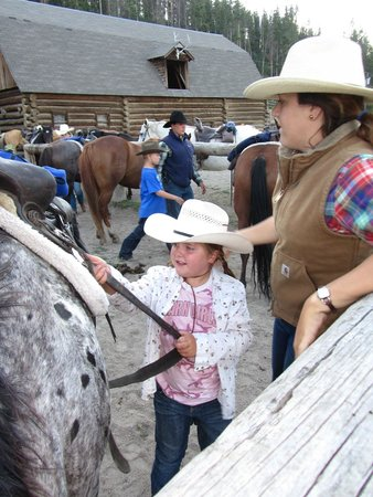 Elkhorn Ranch: Untacking your horse after another great ride