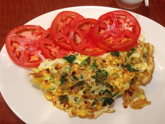 New York Luncheonette: Spinach and feta Omelette with side of tomatoes.