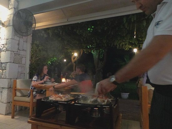 Buzz Beach Bar : Our seafood dinner is being cooked at our table