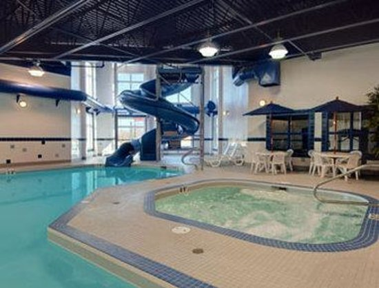 Indoor pool and hot tub with a slide  Indoor Pool with waterslide, hot tub - Picture of Ramada Drayton ...