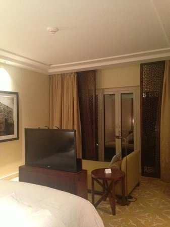 The Ritz-Carlton, Dubai: Club suite showing the hidden tv at the end of bed