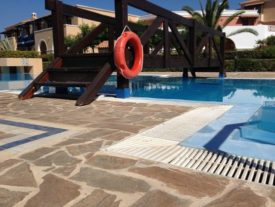 Aldemar Olympian Village: One of the wooden bridges of the pool
