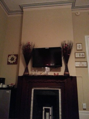 Artist House: TV above fireplace