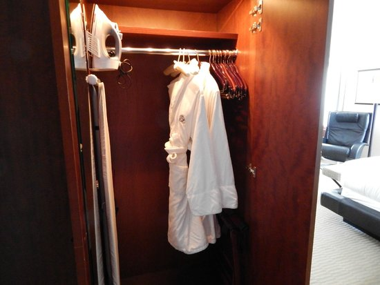 Battery Wharf Hotel, Boston Waterfront: closet with robes, iron, ironing board and umbrella