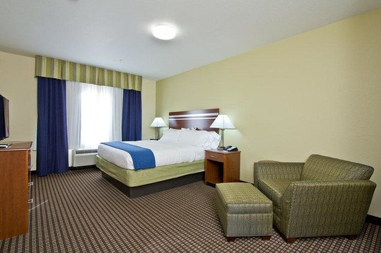 The Timbers Hotel: Holiday Inn Express and Suites Denver East Peoria King Room