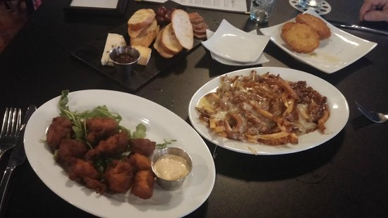 The White Oak Tavern: Hushpuppies, Ham Poutine, Cheese & Chacourterie, Fried Green Tomatoes