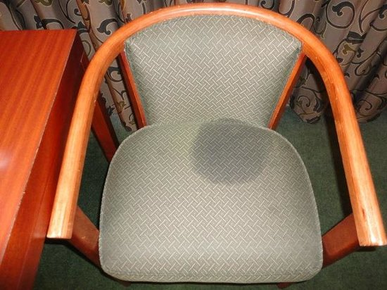 Rodeway Inn: 2nd of 2 stained chairs in room