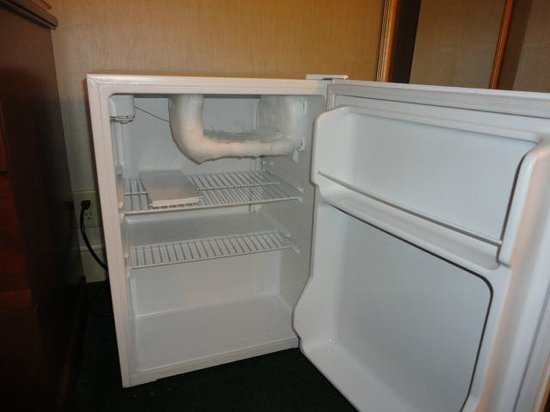 Rodeway Inn : In room fridge - broken freezer door on the top shelf.
