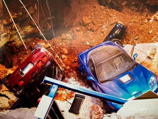 National Corvette Museum: My photo of their photo of the hole and cars