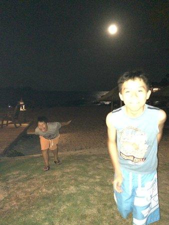Laguna Redang Island Resort: Evening full moon with light over the water.