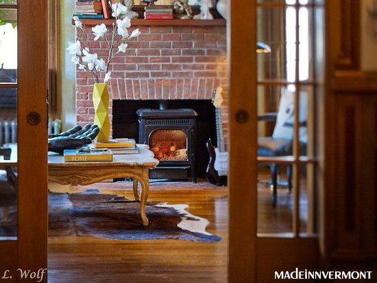 Made INN Vermont, an Urban-Chic Bed and Breakfast : Sitting Room Fireplace w/ 1881 Door