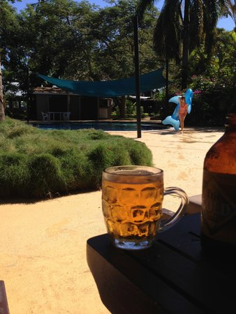 First Landing Beach Resort & Villas: A beer by the pool