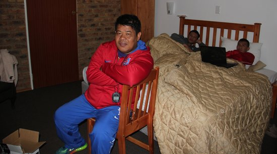 Airport Inn B&B: (Photo caption: A half-frozen Nonoy Neri sits in front of the portable room heater inside Dapudo