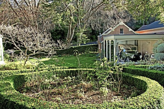Olveston Historic Home: Garden with 1921 Fiat behind glass