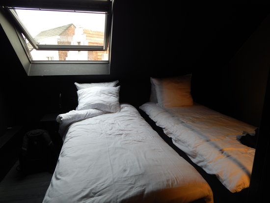 Hotel O  Kathedral: window over bed - cathedral lights on all night