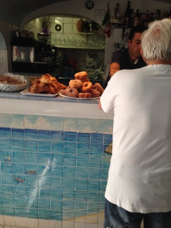 Trattoria Da Armandino: A local getting his coffee and pastry