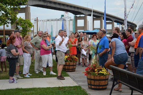 Buffalo History Tours: Discussing Buffalo's history at the boardwalk in Canalside.