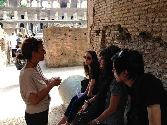 Italy Hotline Custom and Gourmet Tours: In the shade of the colosseum with our guide, Daniela