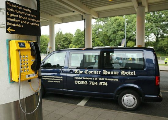 Gatwick Corner House Hotel: minibus at pick up point with freephone in view
