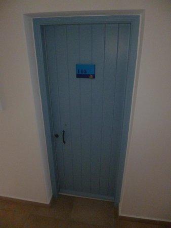 Room 115 and its blue door at Vencia Hotel