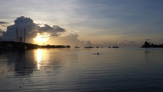 Caye Harbour Lodge: View from the dock, right outside my room at dawn.