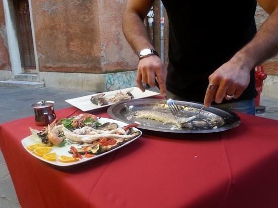 Al Bacco Felice: Table side fish preparation.