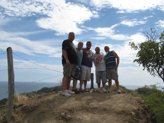 Hotel Riu Palace Costa Rica: The God kids, their Dad and I, taking in the view while ATVing.